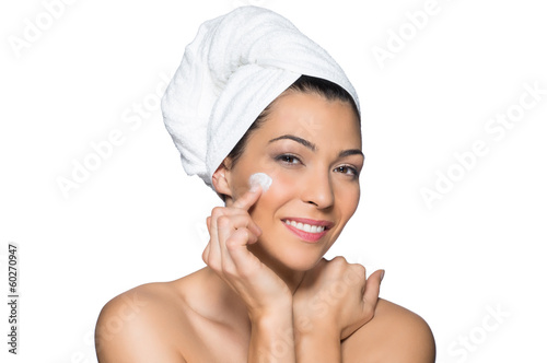 Beautiful Woman Applies Lotion to Her Face
