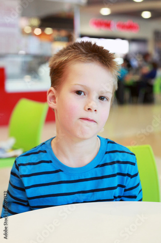 Little boy in the cafe