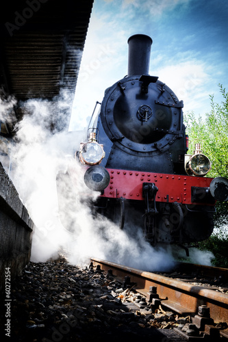 Historical steam engine train in motion