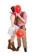 Große Liebe an Fasching - junges Paar küsst sich