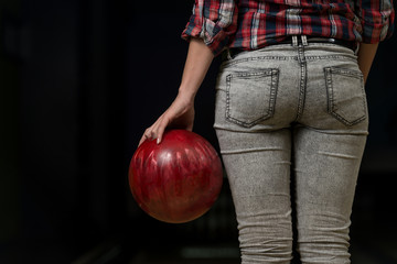 Close-Up Of A Butt Next To A Bowling Ball