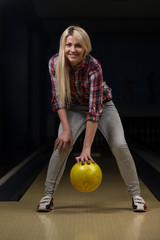Beginner Aiming To Bowling Pins