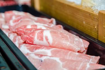 Slices of raw pork