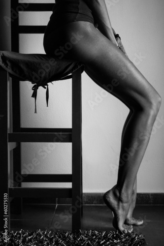 Woman's long legs with a chair © Evgeniya