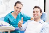 Fototapety Man giving thumbs up at dentist office