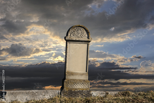 Tombstone on sunset background