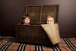 beautiful little children sitting in suitcase