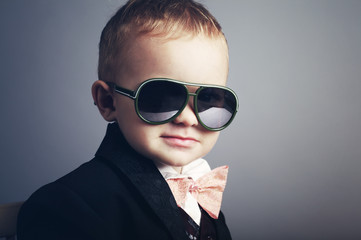 little stylish gentleman with sunglasses