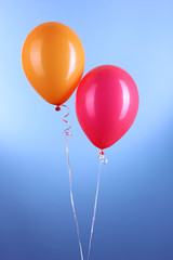 Two colorful balloons on blue background