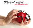 Hands with scary manicure holding red apple, isolated on white