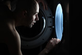 Man Looking inside the washing machine