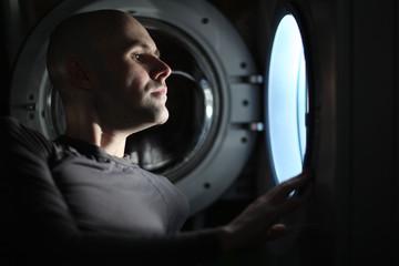 Man Looking inside the washing machine