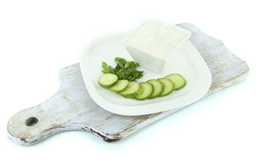 Cucumber yogurt in bowl, on white, isolated on white