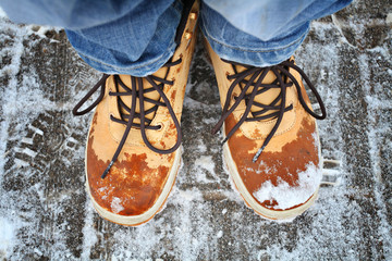 Men's feet in winter boots