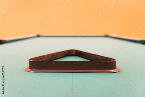 Empty Triangle Standing on Pool Table