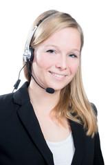 Blonde Frau mit Headset beim telefonieren
