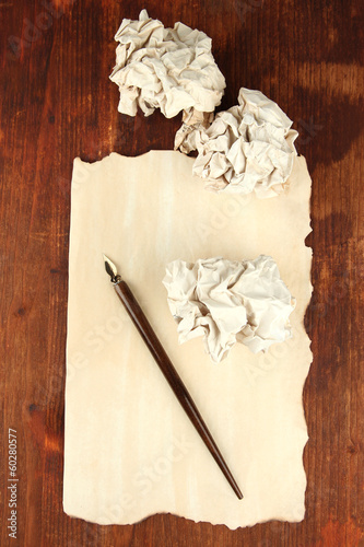 Crumpled paper balls with ink pen on wooden background