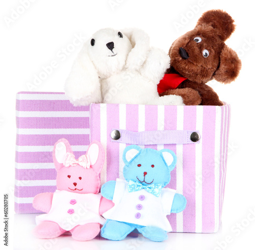 Textile box with toys, isolated on white
