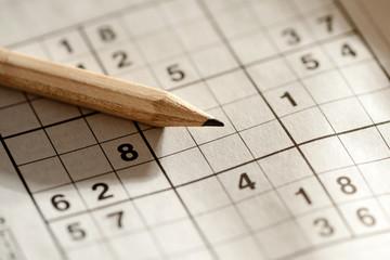 Pencil lying on a sudoku grid