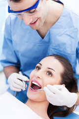 Male dentist with female patient