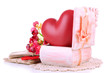 Still life with heart in wooden casket, isolated
