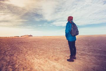 Hiker enjoying the vastness of empty beach