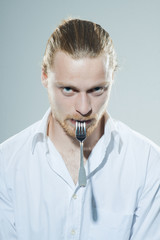 humorous man with fork