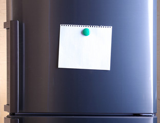 Empty paper sheet on fridge door