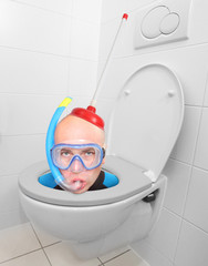Funny picture from hotel bathroom. Crazy scuba diver in the WC.