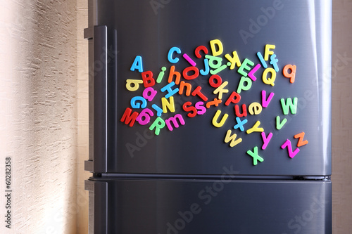 Colorful magnetic letters on  refrigerator