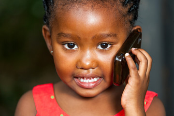 face shot of african girl talking on cell phone.