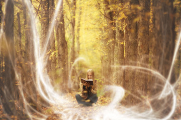 beautiful young girl in a magical forest,