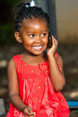 Happy african girl talking on smart phone.