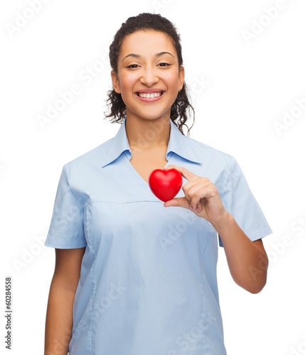 smiling female doctor or nurse with heart