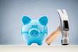 Blue Piggy Bank and a Hammer