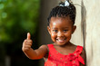 Pretty little african girl showing thumbs up. - 60284971