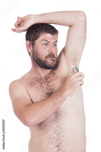 young man with a razor shaving under his arm