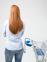 Housewife with a Shopping Cart Making a Choice