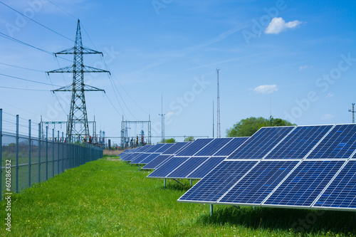 solar panel against high voltage tower