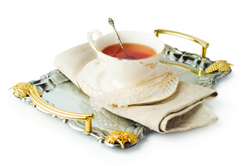 elegant tea cup on a tray with sugar on a stick