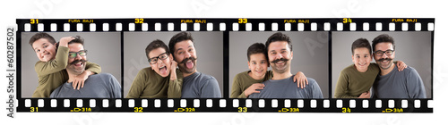 Happy father and son images on old fashioned 35mm filmstrip
