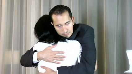 A husband embrace his sad wife