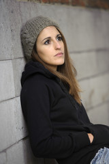 sad young woman with knitted hat