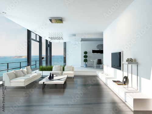 Leinwanddruck Bild Luxury living room interior with white couch and seascape view