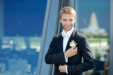 Groom's portrait outdoors