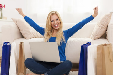 Excited young woman with online shopping
