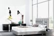 Modern white king-size bed against floor to ceiling window