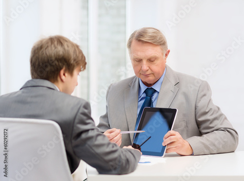 older man and young man with tablet pc