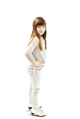 Little girl with ice skates on white background