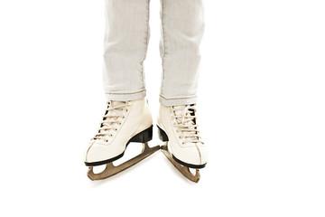 Little Girl's Legs in White Ice Skates On White Background